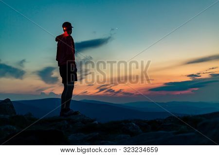 Trail Runner With Head Lamp. Man Celebrating Sunset On Mountain Top. Looking At Inspiring View. Hike