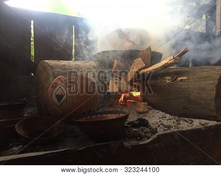 Native Amazonian Way Of Pottery: Clay Mockawas Or Bowls Are Being Baked In Ash On A Fire