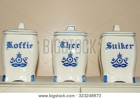 Delft Blue Coffee, Tea, And Sugar (koffie, Thee, Suiker) Containers On A Shelf. Famous Porcelain Sou
