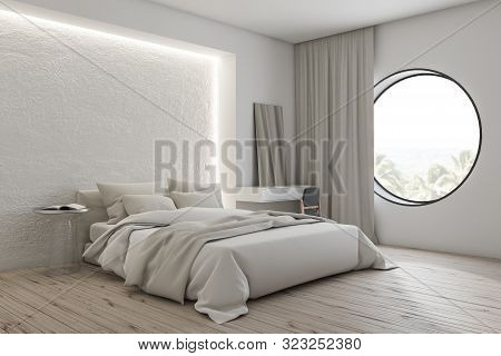 Corner Of Modern Bedroom With White Walls, Wooden Floor, Comfortable Master Bed With White Blanket A