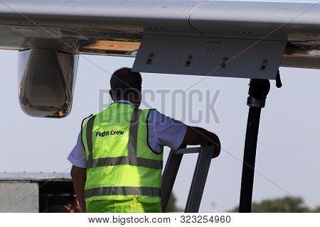 Flight Crew Member Control Refueling Aircraft Process At The Airport