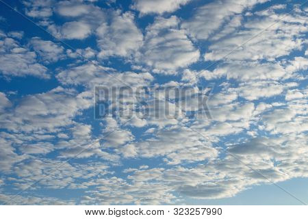Beautiful celestial landscape. Clouds and sun at sunset. Clouds and sun at dawn. The radiance of the sunlight. poster