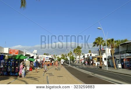 Puerto Del Carmen, Lanzarote, Canary Islands, Spain - September 13, 2019 : Tourists Shopping In Puer