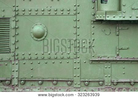 Abstract Green Industrial Metal Textured Background With Rivets And Bolts