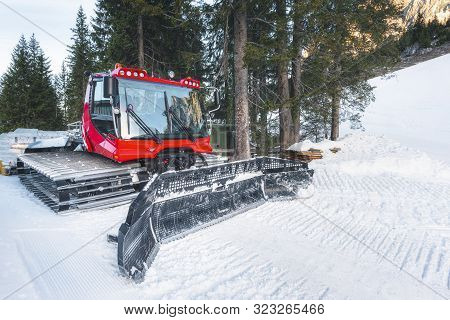 Snow Groomer Car On A Snowy Road In The Austrian Alps Mountains, In Ehrwald, Austria, On A Cold Day
