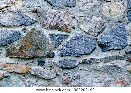 Fragment Of A Wall From A Chipped Stone For Background