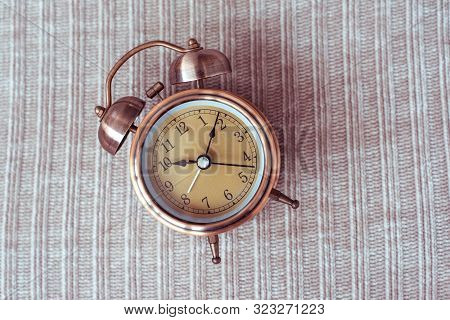 Clock At 10 O Clock In The Morning With Vintage Style Alarm Clock On Knitted Background. Windup Type