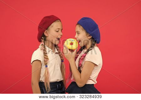Sweets Shop And Bakery Concept. Kids Huge Fans Of Baked Donuts. Share Sweet Donut. Girls In Beret Ha