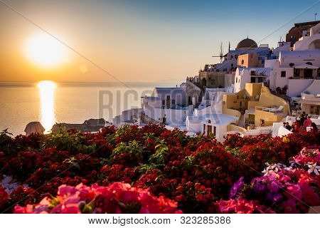 Santorini, Greece - April, 2018: Tourists Looking At The Amazingly Beautiful Sunset At La Caldera In