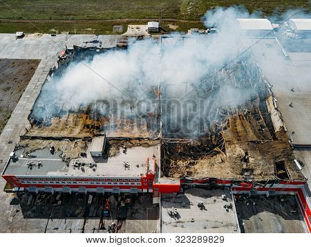 Burning Industrial Distribution Warehouse, Aerial Drone View.