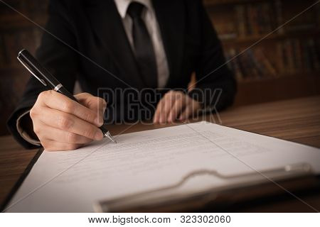 Consultant Lawyer Or Businessman Sign In Important Documents At Law Firm.