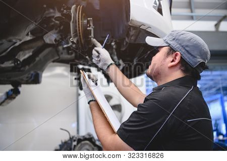 Asian Male Car Technician Car Maintenance For Customers According To Specified Vehicle Maintenance C