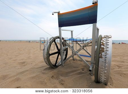 Special Wheelchair Free For The Disabled On The Beach Facing The Sea