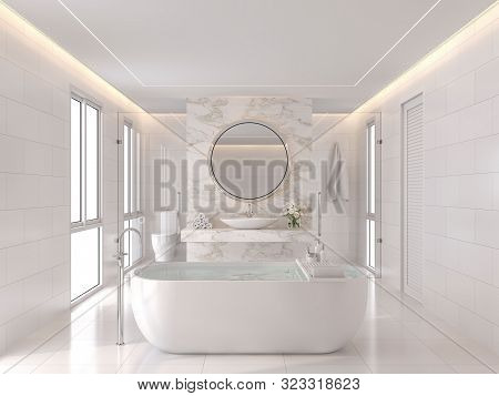 Luxurious White Bathroom Modern Style 3d Render. The Room Has White Tiles And The Wall Is Decorated