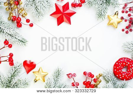 Christmas Background. Xmas Composition Border With Snowy Fir Branch, Red Holly Berries, Gold Stars A