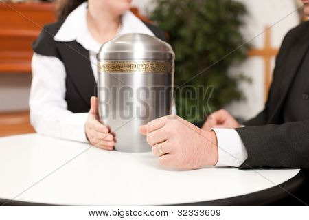 mortician with client comforting and advising