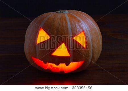 Jack Lantern Glowing Pumpkin For Halloween On Dark Background