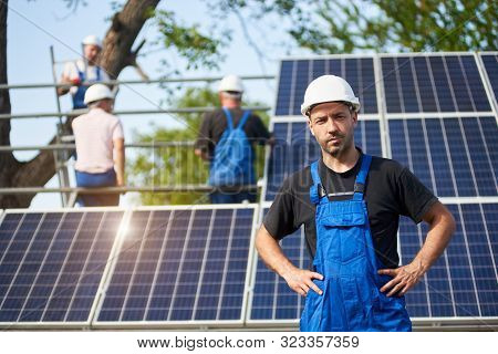 Portrait Of Smiling Successful Engineer Technician Standing In Front Of Unfinished High Exterior Sol