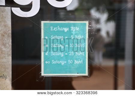 Kanchanaburi, Thailand, 09.09.2019: Information Signboard Shows The Exchange Rate Of The Old Holed C