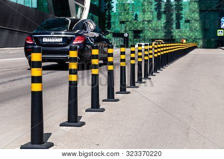 Russia Moscow 2019-06-17 Parking Limiter Black Round Pillows With Yellow Stripes Between Roadway And