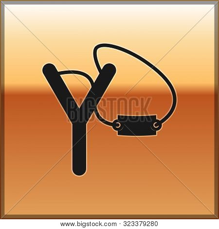 Black Slingshot Icon Isolated On Gold Background. Vector Illustration