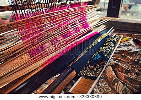 Weaving Fabric. Weaving And Manufacturing Of Handmade Carpets Closeup. Hand Made On A Wooden Loom Ma