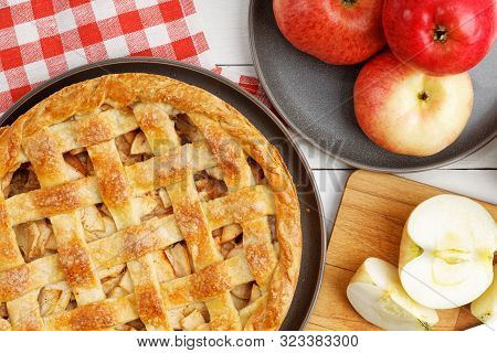 Homemade Apple Pie With Lattice On White Wooden Table. Top View.