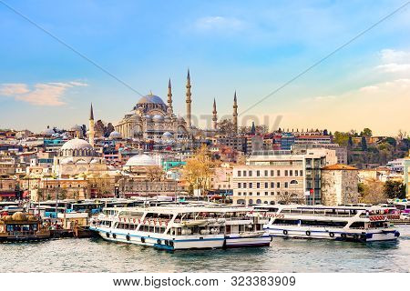 Suleymaniye Camii, The Famous Mosque On Golden Horn And Touristic Boats In Istanbul At Sunset, Turke