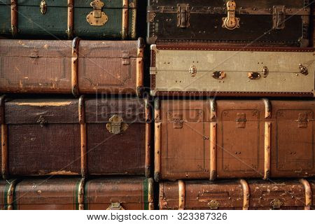 Retro luggages bag background. Pile of colorful vintage suitcases