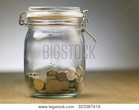 coins in a glass jar,saving for future concept
