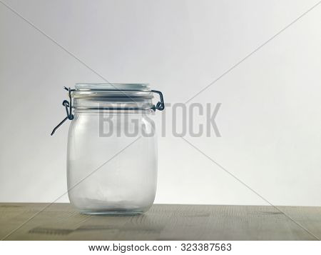 empty glass jar on the wooden table