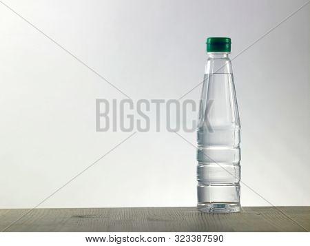 bottle of white vinegar on the wood table