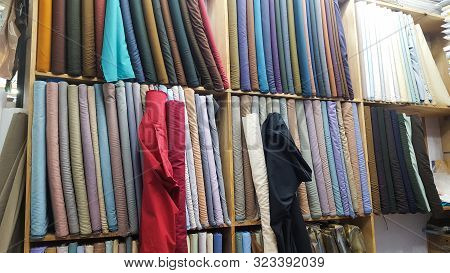 Cloth Shop With Clothing Rolls And Thaan, Kurta Shalwar Kapda