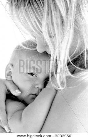 Close Up Portrait Of Mother And Baby Over White