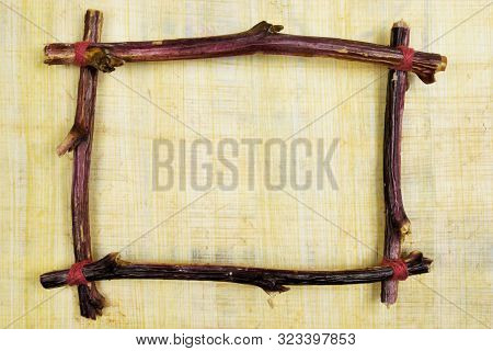 Frame Of Branches For Design On Vintage Egyptian Papyrus. Vintage Art Frame To Indicate Important Te