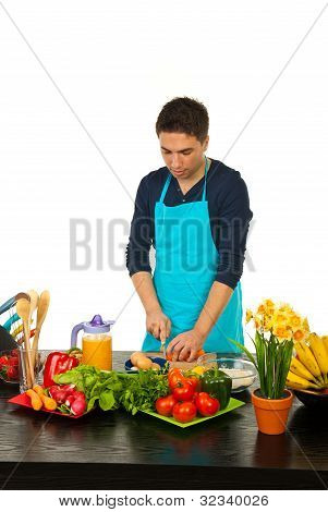 Man Cutting Carrot On Wooden Board
