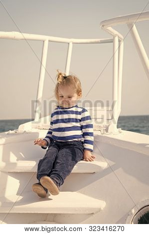 Little Sailor On Boat. Summer Vacation. Childhood Happiness. Sailor Kid In Striped Marine Shirt. Tra