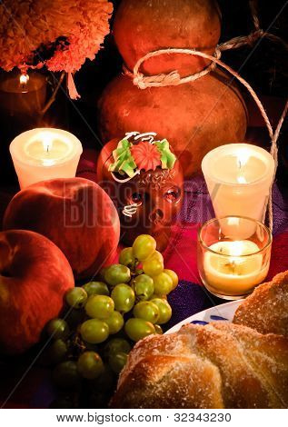 Offering as part of the celebration of the day of the dead in Mexico with bread poster
