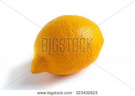 Whole Lemon Fruit. Orange Citrus Isolated On White. Fresh Spanish Organic Lemon With Yellow Peel Clo