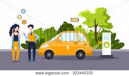 An Electric Car Charges From An Electric Vehicle Charging Station. People Talk To Each Other. Positi