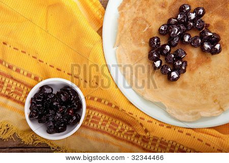 Crepes On The Tablecloth With Cherry