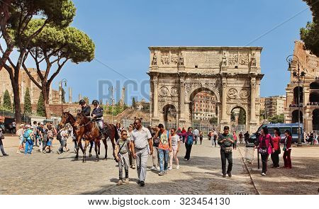 Roma, Italy, April 7, 2018 : Tourists Visiting Arco De Constantino (arch Of Constantine) And Colosse