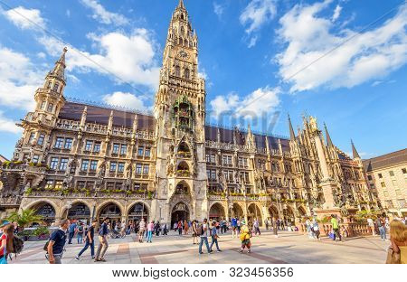 Munich, Germany - Aug 1, 2019: People Visit Marienplatz Square In Munich. Panorama Of Town Hall Or R