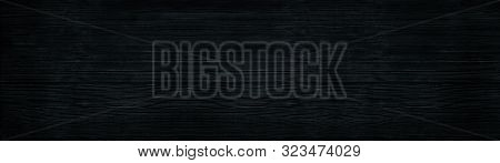 Black Wood Wide Panoramic Texture. Wooden Backdrop Horizontal Panorama. Dark Timbers Surface Backgro