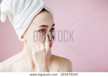 Beauty Cosmetic Peeling. Closeup Beautiful Young Female With Black Peel Off Mask On Skin. Closeup Of