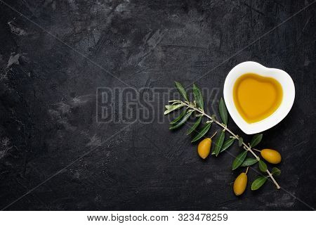 Top View Of Still Life .in The Ceramic Bowl, In The Shape Of A Heart, Extra Virgin Olive Oil, On The