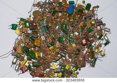 Close Up Of Pile Of Defferent Types Of Ceramic Capacitors Isolated On White Background.