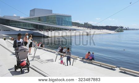 Oslo, Norway - July 24, 2019: Oslo Waterfront With The National Oslo Opera House In Background. Peop
