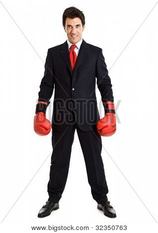 Portrait of a smiling businessman wearing boxing gloves. Isolated on white