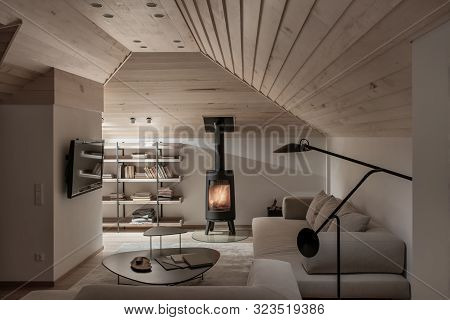Light Illuminated Interior With Sloping Wooden Ceiling